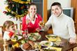 Happy family of three celebrating Christmas
