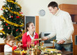 Man serving  table for family in  holiday season
