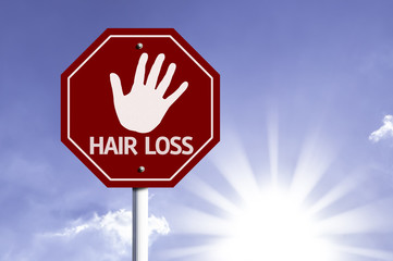 Stop Hair Loss red sign with sun background