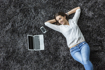 Young woman laying on the carpet