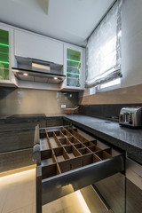 contemporary kitchen interior open drawers