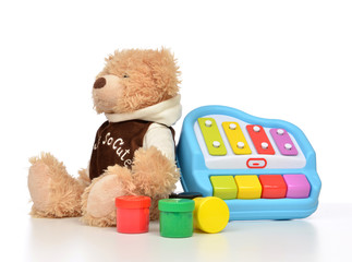 Child baby toys collage with colorfull paints, teddy bear xyloph