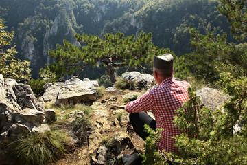 Serbian farmer and highlands landscape