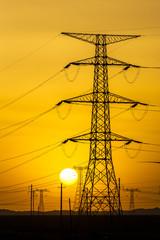 sunset over a windfarm
