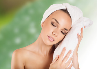 beautiful woman handle towel in spa salon, after bath