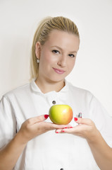 Doctor holding apple with both hands