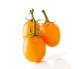 Three Yellow Oblong Tomatoes