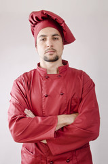 Serious chef posing in studio shot