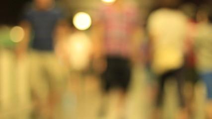 De-focused people walk slow motion night