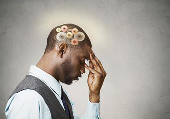 Man thinking hard, gear mechanisms over head, brain power