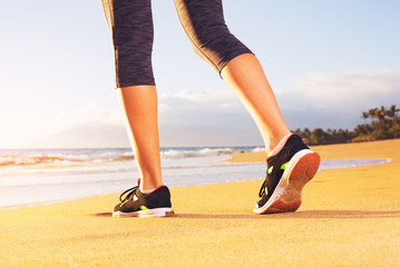 Athlete runner feet on the beach