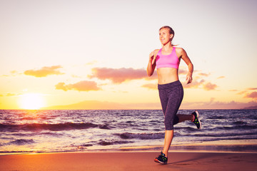 Fitness woman running at sunset