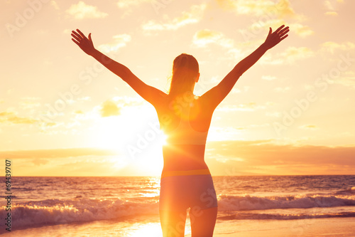Happy Free Woman at Sunset on the Beach - 69439707