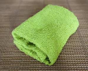 Small towel on straw mat