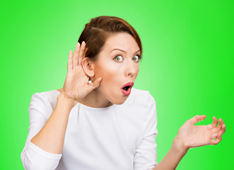 Nosy surprised woman hand to ear gesture, carefully listens