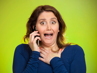 Shocked woman funny looking employee talking on phone