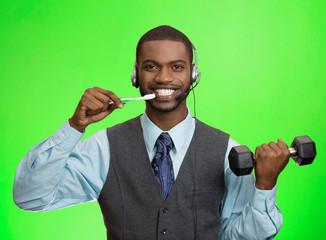 Business man talking on phone, brushing teeth, green background