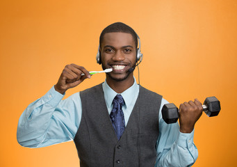 Multitasking businessman on orange background