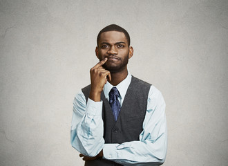 Man skeptic, confused, thinking isolated on grey wall background