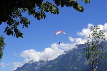 paragliding, parachute over the mountain