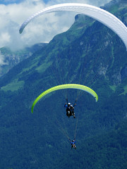 paragliding, parachute over the mountain