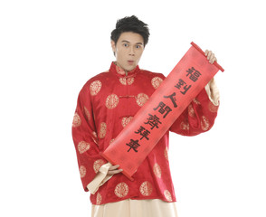 Young Asian man holding red spring couplets for chinese new year