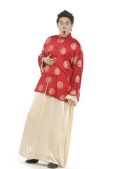 Oriental young man with tradition clothing posing
