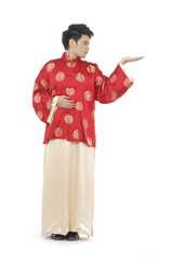 Oriental young man with tradition clothing reaching out