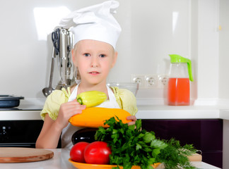 Cute little girl learning to be a chef