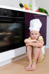 Girl Wearing Chef Hat Waiting Beside Oven for Food