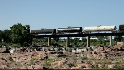 Tourist and train on beautiful falls of Sioux Falls, South Dakot