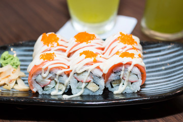Sushi lunch with soup salad green tea and sauce