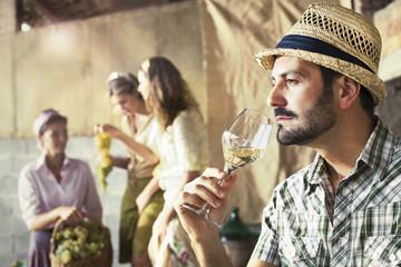 farmer taste a glass of white wine