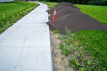 Sidewalk landscaping with topsoil