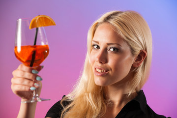 Beautiful young woman drinking aperol spritz