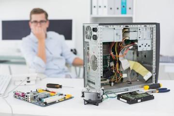 Computer engineer looking at broken console
