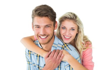Attractive couple embracing and smiling at camera