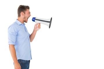 Angry man shouting through megaphone