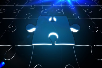 Blue glowing jigsaw piece on puzzle
