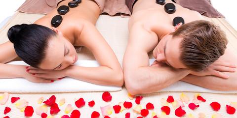 Beautiful couple relaxing in spa salon.