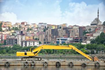 Excavator Parked On An Islet, Istanbul, Turkey