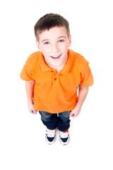 Portrait of adorable happy boy looking up.