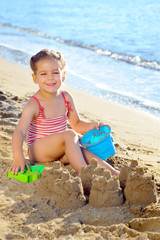 Toddler girl at beach
