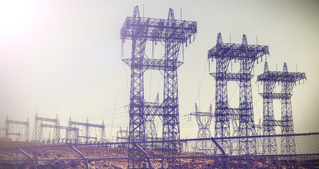 Vintage retro picture of pylons and transmission power lines.