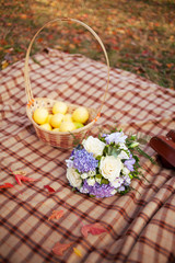 Wedding flowers bouquet  and basket of yellow organic apples and