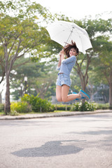 Jumping with umbrella