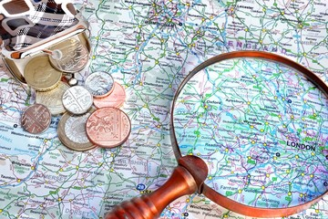Map of England, vintage magnifying glass and small purse