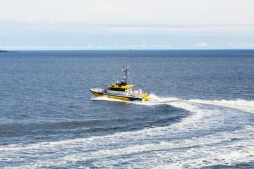 Yellow Pilot Boat Curving Through Water