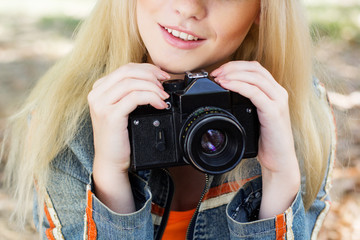 Nice blonde girl photographer with camera
