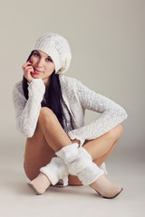 Girl in warm clothes on white background.